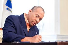 Gov. Patrick signs the fiscal year 2013 budget on July 8, 2012.