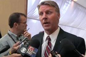 Former Massachusetts Treasurer Timothy Cahill awaits news on whether he'll be retried.