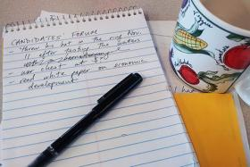 A reporter&#039;s election-year toolkit: coffee mug, steno pad and clichs.