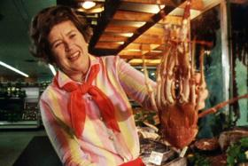 julia child holding a crustacean