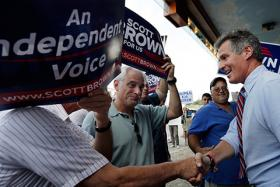 Sen. Scott Brown shakes hands with supporters in Dedham, Mass., as he campaigns for re-election on Aug. 23, 2012.