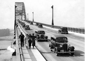 June 23, 1935: More than 30,000 automobiles traversed the great new Cape Cod Canal highway bridges on the opening of the new four-lane highways. This picture shows cars going across the Bourne Bridge as seen from the south.