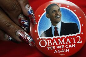 A delegate shows off her button on the eve of the Democratic National Convention in Charlotte, N.C.