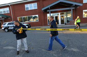Federal agents investigate the offices of the New England Compounding Center in Framingham, Mass., on Oct. 23, 2012. The company's steroid medication has been linked to a deadly meningitis outbreak.