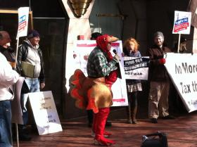 An unidentified activist dressed as a turkey, wore a sign that read 