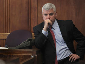 District Attorney Daniel Conley waits for word about the jury's decision as the jury in the quadruple Mattapan homicide trial of Edward Washington and Dwayne Moore deliberates for a sixth day at Suffolk Superior Court in Boston, Wednesday, March 21, 2012.