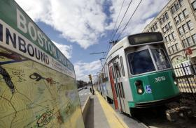 In this April 5, 2012 photo, an MBTA train pulls into a stop on Commonweath Avenue near Boston University in Boston.