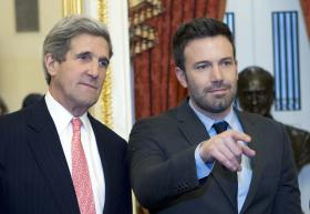 Sen. John Kerry, D-Mass., speaks with actor Ben Affleck during a meeting with foreign relations members to discus the crisis in the Democratic Republic of Congo on Capitol Hill in Washington on Wednesday, Dec. 19, 2012.