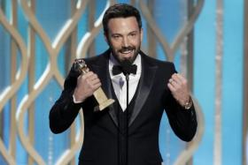 BenAffleck with his award for best director for Argo during the 70th Annual GoldenGlobe Awards at the Beverly Hilton Hotel on Jan. 13, 2013, in Beverly Hills, Calif. (AP Photo/NBC, Paul Drinkwater)