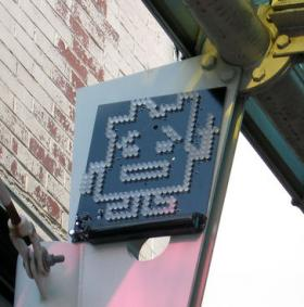 One of the Aqua Teen Hunger Force LED signs hung in Cambridge.