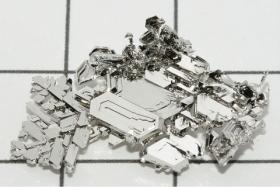 These are crystals of pure platinum grown by gas phase transport. Imagine a coin made out of this. And worth a trillion dollars.