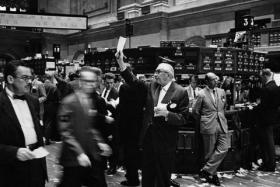 Traders on the New York Stock Exchange floor in 1963. MIT Prof. Andrew Lo said evolutionary biology can explain the investment decisions traders like these make every day.