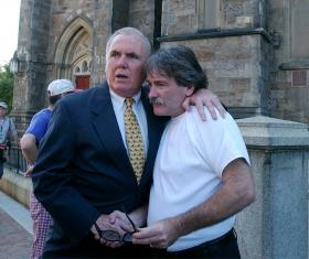 Bernard McDaid, right, alleged victim of sexual abuse, speaks to former Boston Mayor RayFlynn, a former U.S. ambassador to the Vatican, in front of the Cathedral of the Holy Cross in Boston Wednesday, July 30, 2003, before Bishop Sean O'Malley's installat