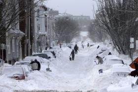 Residents on Second Street South Boston begin shoveling out their cars.