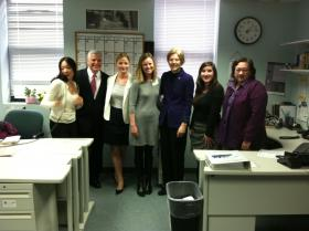 Suffolk County DA Dan Conley and U.S. Sen. Elizabeth Warren with the staff of Casa Myrna in Boston