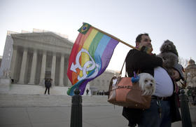Gay marriage supporters on the steps of the Supreme Court. The Court handed down historic rulings on Wednesday.