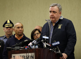 Boston Police Commissioner Ed Davis speaks as Massachusetts Gov. Deval Patrick listens, second from left, at a news conference in Boston Monday, April 15, 2013 regarding two bombs which exploded in the street near the f