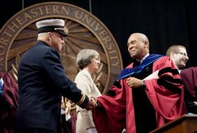 Gov. Deval Patrick greets a first responder at Northeastern University commencement.