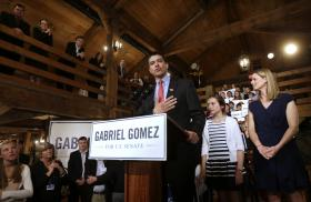 Republican candidate for the U.S. Senate Gabriel Gomez, center, addresses an audience during a victory speech as his daughter Antonia, 10, second from right, and wife Sarah, right, look on at a watch party, in Cohasset, Mass., Tuesday, April 30, 2013.