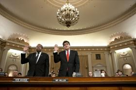 Ousted IRS chief Steven Miller, right, and J. Russell George, the Treasury inspector general for tax administration, are sworn in on Capitol Hill in Washington, Friday, May 17, 2013. prior to testifying before the House Ways and Means Committee hearing on