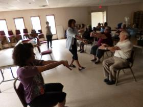 Community health workers lead a yoga class.