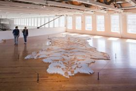 This rug, by artist Xu Bing is made of 500,000 cigarettes.