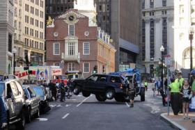 Workers prepare a Boston street to shoot a scene for R.I.P.D. That film is one of many summer blockbusters that has underperformed.