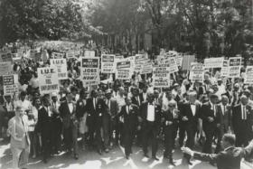 Dr. Martin Luther King, Jr. leading a crowd of supporters on the day of the famous March on Washington for Jobs and Freedom.