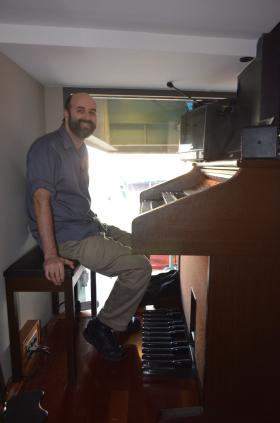 Fenway Park organist Josh Kantor plays live throughout the game from this organ tucked in the corner of the ballpark.
