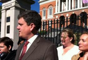 Mayoral candidate John Connolly addresses the Boston school bus driver's strike outside the State House Tuesday.