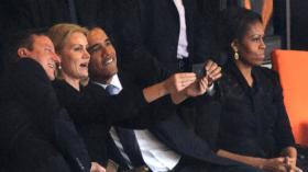 President Obama and British Prime Minister David Cameron pose for a picture with Denmark's Prime Minister, Helle Thorning Schmidt, during the memorial service for Nelson Mandela Tuesday in Johannesburg, South Africa. First lady Michelle Obama is on the ri