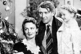 Scene from the 1946 film with Donna Reed, Jimmy Stewart and Karolyn Grimses (from left).