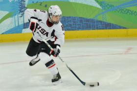 Caitlin Cahow in action against the Russian national hockey team. Cahow is one of three openly-gay delegates who will represent the US at the 2014 Winter Games.