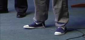 A defendant cuffed at the feet at the Boston Mental Health Court.