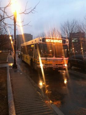 An Out of Service MBTA bus pulls in to the Haymarket Station.