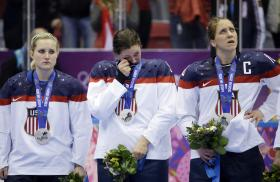 USA players react after losing the gold medal ice hockey game to Canada 3-2 in overtime at the 2014 Winter Olympics, Wednesday, Feb. 19, 2014, in Sochi, Russia.