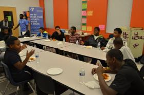 The YMCA in Hyde Park holds family style dinners one night a week. Dinners are free to all kids, as long they complete one chore, such as cooking, prepping or cleaning.