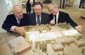 Architect Norman Foster, left, Malcolm Rogers, center, director of the Museum of Fine Arts in Boston, and Spencer de Grey, partner-in-charge of Foster and Partners, pose with a model of a new expanded MFA design.