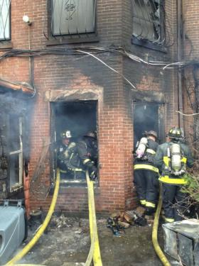 Two Boston firefighters died on Wednesday fighting a nine-alarm fire that broke out in a Back Bay brownstone.