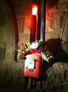 Flowers were left at the firehouse on the corner of Boylston and Hereford Streets.