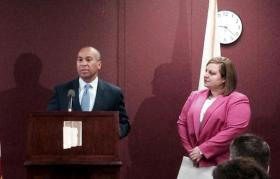 Gov. Deval Patrick introduces interim Department of Children and Families Commissioner Erin Deveney.