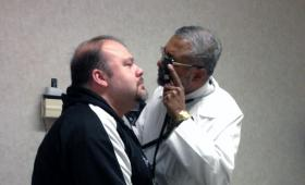Dr. George Abraham examines his patient, Jason Lizotte.