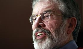 In this Tuesday, Dec. 31, 2013 file photo, Sinn Fein President Gerry Adams speaks to the media at Stormont Hotel, Belfast, Northern Ireland.