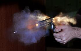 A bullet is fired from a gun.