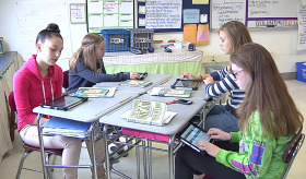 Students in English class at Oak Middle School in Shrewsbury use tablets to answer teacher questions.