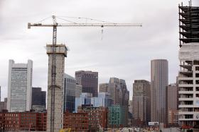 In this Friday, April 4, 2014 photo several commercial construction projects in the Seaport district of Boston are seen against the backdrop of the city skyline. Friday, April 4, 2014.