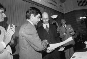 Spencer Sacco, grandson of Nicola Sacco, who along with Bartolomeo Vanzetti was executed 50 years ago, receives a proclamation from Massachusetts Gov. Michael S. Dukakis, left, saying that the Sacco-Vanzetti trial was unfair, July 19, 1977 in Boston.