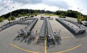 in this photo taken with a fisheye lens, shopping carts are arranged forming the letters ATD in the parking lot of a Market Basket Supermarket in North Andover, Mass., Monday, Aug. 11, 2014, in support of former CEO Arthur T. Demoulas.