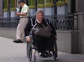 Christine Griffin navigates Beacon Hill in her wheelchair.