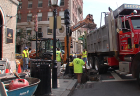 Ramp construction begins on Beacon Hill, at the corner of Charles and Beacon Streets.